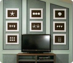 I really like this for some reason. Maybe not the shells, but I like the walls and white frames with the brown...