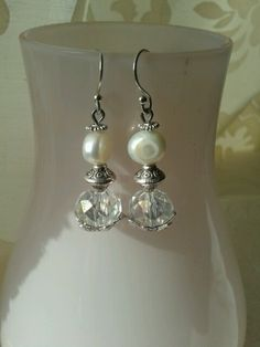 """Silver earrings """"snowdrop"""" by Tanja klaassen for BlinQBlinQ.nl . Pearl, Swarovskibead and silver. I"""