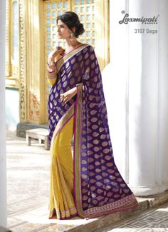 Chiffon yellow golden jari worked saree is made the diffference with its violet viscose material pallu.