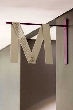 Alphabet Beige Bent over Color Accent font Grid Logo Mesh Metal Overlaid Lines