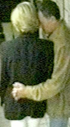 Dodi embraces Diana at the Ritz in Paris.  They are about to leave....