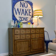 Add nautical rustic charm to your entertaining or bar area with this distressed No Wake Zone wall art. Check out all the coastal and beach decor at your local HomeGoods. Sponsored Happy By Design Post