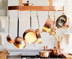 Serious chefs agree that copper pots are the best: They last forever, warm quickly, and gleam beautifully. Treat them as an art installation: Prominently hang your collection on a pot rack for all to admire.