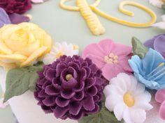 Campanilla, margarita, dalia, flor de manzano.....realizadas en glasé real. Rosa María Escribano