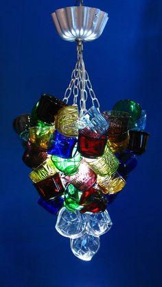 Repurposed punch cups, glass dishes create this funky & fun chandelier. Outdoor Chandelier, Chandelier Shades, Glass Chandelier, Chandelier Lighting, Chandelier Ideas, Recycled Glass, Recycled Art, Glass Dishes, Cool Lighting