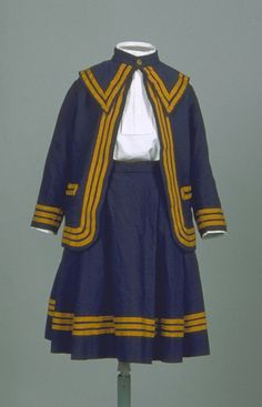Date Made: 1833-1880  Description:  Suit; three piece, jacket, pants, and skirt, navy wool with mustard twill tape creating stripes at edges.
