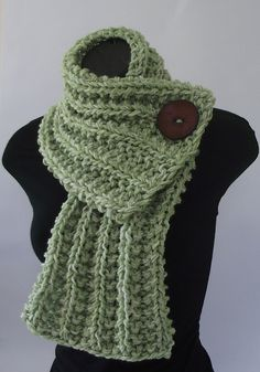 A beautiful hand knit cowl created out of a green and white yarn. The chunky ribbed pattern and large chocolate brown button makes this cowl comfy and stylish. The soft yarn and close weave ensure quality and warmth.  Chunky weight yarn.  Dimensions: 8.00 inches x 32.00 inches