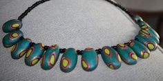 Kudin mukana: Polymeerimassa: Mallaviri's turqoise oval beads