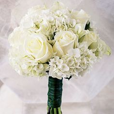 Amore in Anguilla | The bride's wedding bouquet was all white, with hydrangeas and roses.