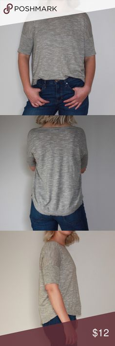 Ann Taylor Loft Outlet Heather Green Sweater Short sleeve sweater in heathered green color. Sweater is a fine knit in great condition, no holes or stains. It is a size small and has a loose fit. Looks great worn alone, or layered (can be worn under cardigan/jacket or over a button up). LOFT Sweaters Crew & Scoop Necks
