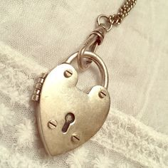 Fossil silver heart locket necklace Beautiful Fossil vintage silver tone heart locket necklace. New without tags (NWOT). Locket opens up, magnetic closure. Has a bit of a tarnished vintage look to it, meant to look this way. Lobster claw closure. A really cute necklace! Fossil Jewelry Necklaces
