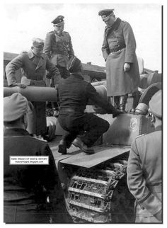 Men of the Leibstandarte 1st SS division with a Tiger tank, Guderian listens.