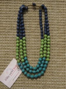 Three strand necklace with color-blocked monaco blue, bright green, and light emerald hand-made paper beads. Bead-in-eye clasp. Princess length, about 18 inches. $25