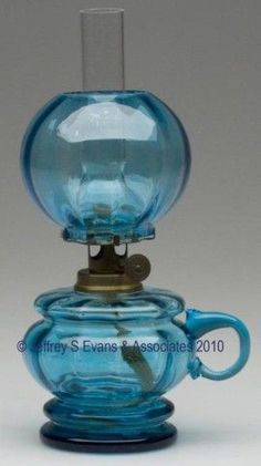 """HULSEBUS II, FIG. 52 / PANEL OPTIC FOOTED FINGER LAMP, peacock blue, applied handle, matching patterned ball shade, period burner. 6 1/4"""" h to top of shade, 2 1/2"""" dia base.  Handle lacking the tip of curl, otherwise undamaged. Reference: Parallels Smith I, fig. 49.  Provenance: From the collection of Jo Ann Dreyer."""