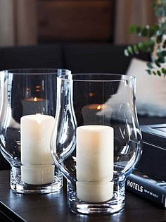 Glass hurricane lanterns, block candles.