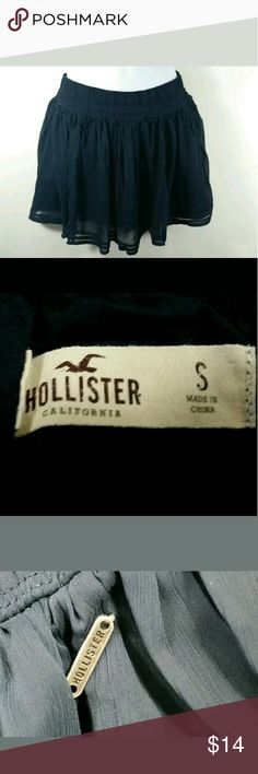 """Navy Blue Hollister Mini Skirt Small Layers Hollister's ALine Mini Skirt with Flowing Layers  Juniors Size Small  Navy Blue  Measurements Taken With Garment Lying Flat: Waist 25.5 Inches (Elastic) Length 13 Inches  Excellent Used Condition - The only flaw found during inspection and photographing is that the metal """"Hollister"""" tag is only connected on one side. Otherwise perfect! Hollister Skirts Mini"""