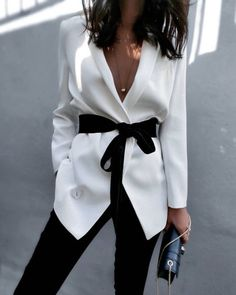 White blazer with a black bow