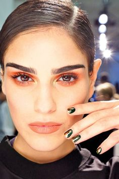 Metallic gold and pine green are a subtle take on holiday nail art.