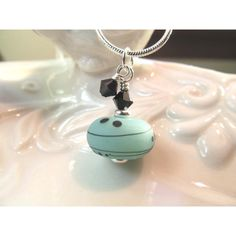 Necklaces teal green Lampwork glass bead with black and white details,... (29 CAD) ❤ liked on Polyvore featuring jewelry and necklaces
