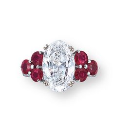 A DIAMOND AND RUBY RING. Set with an oval-shaped diamond weighing carats, flanked by the trefoil circular-cut ruby shoulders, mounted in white gold, ring size Ruby Jewelry, Pandora Jewelry, Stone Jewelry, Diamond Jewelry, Jewelery, Diamond Pendant, Diamond Rings, Ruby Rings, Emerald Rings