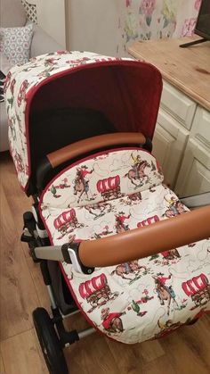 Bugaboo hood and apron made in cath kidston cowboy fabric
