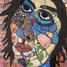 Kitchen Goddess. Mosaic face..love the variety of tiles used!