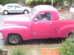 A pink vintage Holden ute - so cool!