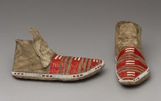 Buckskin, with row of white and red beads above sole; decorated in quillwork, coral-red and whitebeadwork.