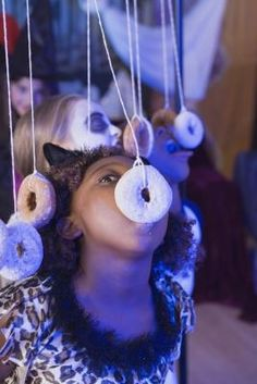 Dangling Donut This old-school party game is fun for everyone and makes for hilarious pics for the scrapbook. Tie string through the holes of donuts and attach to something secure overhead, or a broom handle or yardstick that two parents hold. Then invite the kids to chow down—no hands allowed!