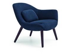 Poliform_Mad Chair armchairs with fabric covered body and legs in solid wood in spessart oak finishing. The asymmetrical versions accompany the armchair with two armrests, suggesting the utmost freedom of combinations.