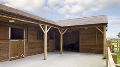 We created this L-shaped block with two stables, oak beams, open store and feed…