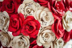 Paper flowers. http://marrymeink.co.uk/2014/02/13/a-diy-psychobilly-wedding-with-1000-paper-flowers-steph-adam/