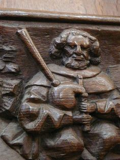 Loure player or norman bagpiper (see. Sculpture from the Collegial chruch of Mortain (Normandy), from the end of the Middle Age