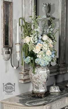 Gray, light tones complimented by beautiful florals and accessories