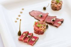 Discover a heavenly match of veal and tuna with Chef Michele Laiso's 'Veal and Tuna Pairing with Slow-cooked Veal Tenderloin, Smoked Beef Tartar, Seared Tuna Loin and Tuna Tartar Served with Tuna Sauce, Rocket Salad, Lemon Zest, and Capers' at the Portofino, at Le Meridien Phuket Beach Resort