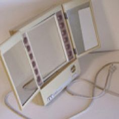 """Clairol lighted make-up mirror....I loved this and mine you could make the lights different colors, like for """"evening""""...it was great!"""