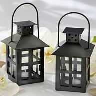 Black tea light lanterns are great table decorations or wedding favors. #exclusivelyweddings #blackandwhitewedding #weddings