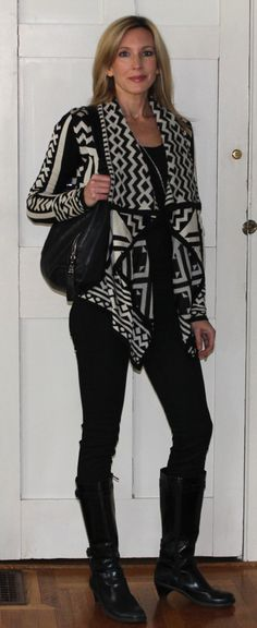 The graphic sweater is the star of this outfit, so make it pop with a black base layer and an oversize turquoise necklace.  Add a little elegance with a pair of Top of the Boot faux fur boot toppers in black mink. www.mytopoftheboot.com