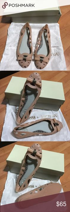Melissa + Jason Wu Light Pink Flats NWT. Textured ribbons of soft, interwoven PVC form these playful Melissa flats. Rubber sole. Comes with dust bag and shoebox. I have these in other colors and they are so cute and so comfortable to wear. Love them. Melissa Shoes Flats & Loafers