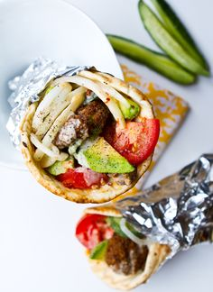 gyros is one of the most common Greek foods. With souvlakia, salad and chips in them who could say no?!?