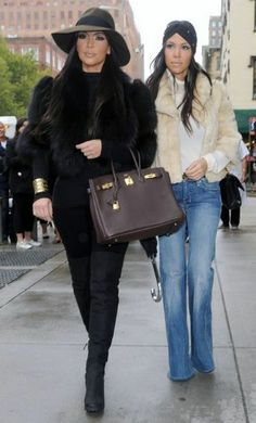 Kicking off their work week, Kim and Kourtney Kardashian were spotted out in New York City this morning (October 4).