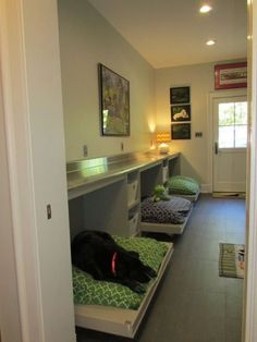 Mud room - counter and dog bed combo. Example of a trendy galley utility room design in Other with flat-panel cabinets, medium tone wood cabinets, stainless steel countertops, gray walls and porcelain floors Animal Room, Utility Room Designs, Utility Room Ideas, Dog Bedroom, Puppy Room, Dog Spaces, Stainless Steel Countertops, Niches, Dog Rooms