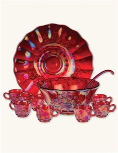 *RUBYWARE PUNCH BOWL SET ~ Carnival Glass, cast from a century-old collection, this dazzling opalescent glass marries all of the colors in existence within crimson. 8 cups, plate, bowl and ladle. Antique Dishes, Antique Glassware, Vintage Dishes, Vintage Dinnerware, Vintage Kitchenware, Vintage Pyrex, Vintage Items, Punch Bowl Set, Crystals