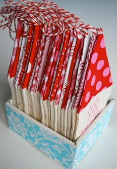 mamas kram: Adventshäuschen Advent houses made of fabric covered poster board, with a pocket in front  for small presents and a string to hang them in December for  Advent.  Store flat in a small box! Beautiful idea!