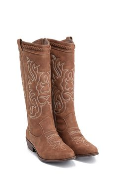 342fbaa225 Just because you aren t a cowgirl doesn t mean you can t enjoy a cool  cowboy boot! Maude by JustFab features a stitched design that looks perfect  with ...