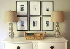 Decoração com fotos pequenas em grandes molduras