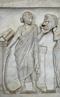 Thalia, muse of comedy, gazing upon a comic mask (detail from Muses' Sarcophagus)