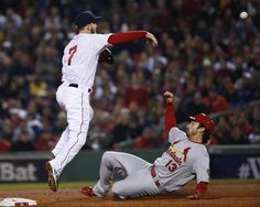 Boston Red Sox shortstop Stephen Drew (7) throws over St. Louis Cardinals' Matt Carpenter (13) to turn a double play on a hit by Carlos Beltran during the third inning of Game 6 of baseball's World Series Wednesday, Oct. 30, 2013, in Boston. (AP Photo/Elise Amendola)