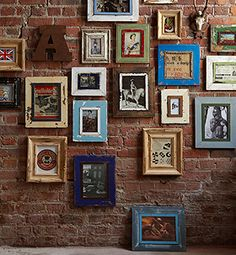 i love the distressed, mismatched frames and completely obsessed with exposed brick walls