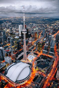CN Tower and Rogers Centre / City of Toronto - A photo from my flight over the beautiful city of Toronto, which happened to be right before a storm passed over the city which you can see in the distance. Toronto Canada, Toronto City, Canada Canada, Backpacking Canada, Canada Travel, City Aesthetic, Travel Aesthetic, Fotos Do Canada, Torre Cn